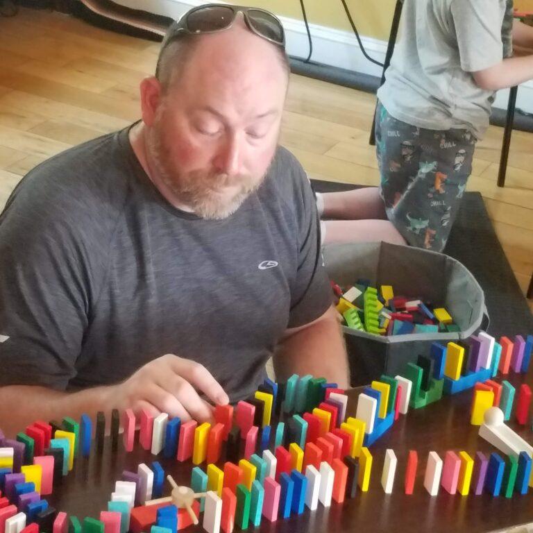 Paul playing dominoes