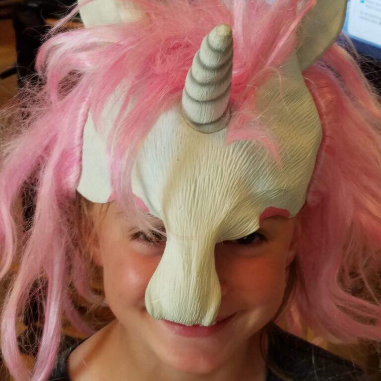 Kid in unicorn mask